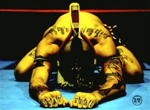 muay thai boxing fighter bowing during a ram muay before a fight